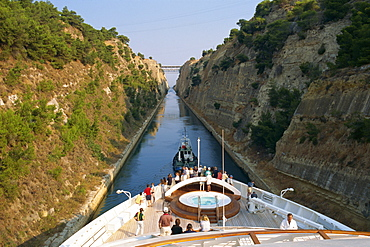 Tourists on the bow of a ship being pulled by tug through the Corinth Canal, Greece, Europe