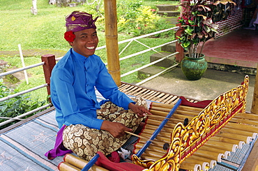 Portrait of a man playing the xylophone on Bali, Indonesia, Southeast Asia, Asia