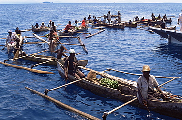 Outrigger canoeists visting cruise ship, Nosy Be, Madagascar, Indian Ocean, Africa