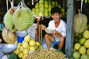 Fruit seller in market, Ho Chi Minh City (formerly Saigon), Vietnam, Indochina, Southeast Asia, Asia