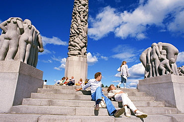 People relaxing on steps before sculptures on the central stele in Frogner Park (Vigeland's Park), Oslo, Norway, Scandinavia, Europe