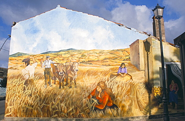 Painting by Pina Monne on side of house, evoking nostalgia for harvests in the rural past, Tinnura village, near Bosa, Sardinia, Italy, Europe