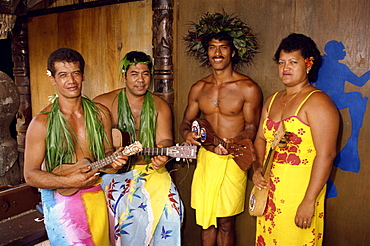 A group of Polynesian musicians welcome visitors to Moorea, Tahiti, Pacific Islands, Pacific