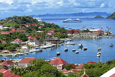 Aerial view over Gustavia, with cruise ship anchored offshore, St. Barthelemy (St. Barts), Leeward Islands, West Indies, Caribbean, Central America