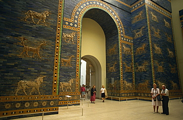 Tourists listen to recorded description of Ishtar Gate, Babylonian dating from the 6th century BC, Pergamon Museum, Berlin, Germany, Europe