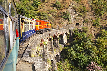 The Himalayan Queen toy train crossing a viaduct, on the Kalka to Shimla Railway, UNESCO World Heritage Site, Northwest India, Asia