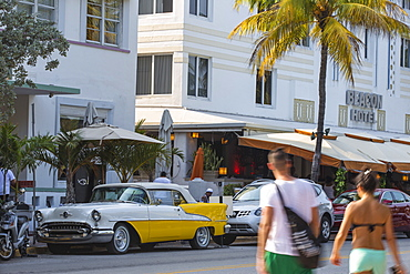Yellow and white vintage car parked outside Avalon Hotel, Ocean Drive, South Beach, Miami Beach, Miami, Florida, United States of America, North America