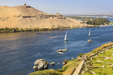 View of River Nile, Tombs of the Nobles on the West Bank, Elephantine Island, and the gardens of the Movenpick Resort, Aswan, Upper Egypt, North Africa, Africa