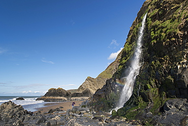 Waterfall cascading over a sea cliff at Tresaith, Ceredigion, West Wales, United Kingdom, Europe