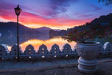 Dramatic sunrise at Kandy Lake and the Clouds Wall (Walakulu Wall), Kandy, Central Province, Sri Lanka, Asia