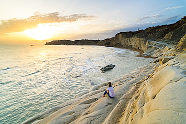Tourist watching the sunset on Scala dei Turchi, Realmonte, Agrigento, Sicily, Italy, Mediterranean, Europe