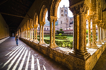 Tourist at Duomo di Monreale (Monreale Cathedral) in the courtyard gardens, Monreale, near Palermo, Sicily, Italy, Europe