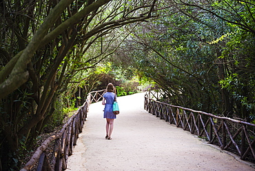 Tourist at the Quarry Garden at the Archaeological Park of Syracuse (Siracusa), UNESCO World Heritage Site, Sicily, Italy, Europe