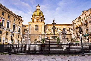 Pretoria Fountain in Piazza Pretoria with the dome of Church of San Giuseppe dei Teatini, Palermo, Sicily, Italy, Europe