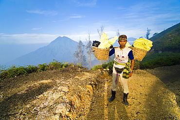Portrait of a sulphur miner at Kawah Ijen, Java, Indonesia, Southeast Asia, Asia