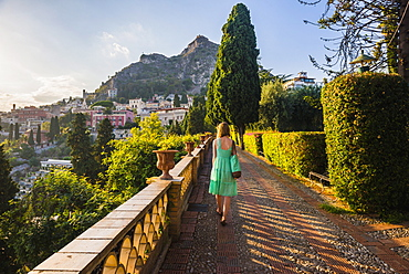 Tourist walking around Taormina public gardens, Taormina, Sicily, Italy, Europe