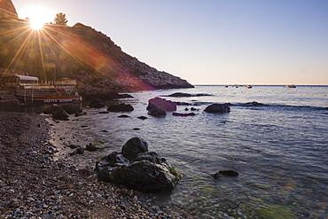 Sunstar at Isola Bella Beach at sunrise, Taormina, Sicily, Italy, Mediterranean, Europe