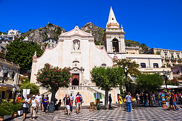 Tourists visiting Church of St. Joseph in Piazza IX Aprile on Corso Umberto, the main street in Taormina, Sicily, Italy, Europe