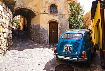 Fiat 600 on the cobbled side street of Castelmola a typical Sicilian village near Taormina, Sicily, Italy, Europe
