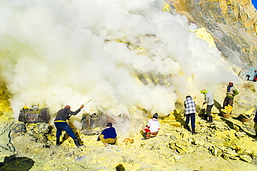 Sulphur miners working in the crater at Kawah Ijen, Java, Indonesia, Southeast Asia, Asia