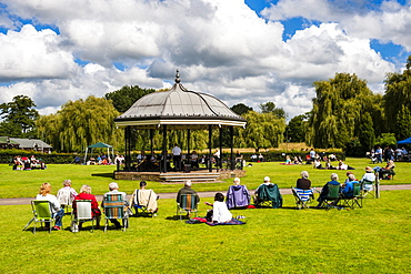 People watching a performance at the bandstand, Godalming, Surrey, England, United Kingdom, Europe