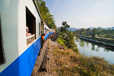 Tourists on a train ride on the Death Railway along the River Kwai, Kanchanaburi, Thailand, Southeast Asia, Asia