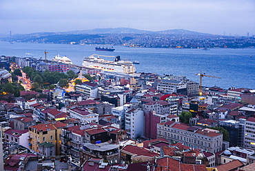 Bosphorus Strait and cruise ship at night seen from Galata Tower, Istanbul, Turkey, Europe