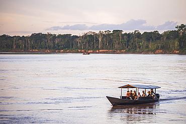 Amazon Jungle boat trip at sunset, Tambopata National Reserve, Peru, South America