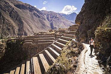 Woman exploring Inca Ruins of Ollantaytambo, Sacred Valley of the Incas (Urubamba Valley), near Cusco, Peru, South America