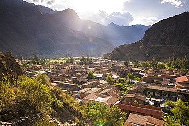Ollantaytambo Inca Ruins at sunset seen behind Ollantaytambo Town, Sacred Valley of the Incas, near Cusco, Peru, South America