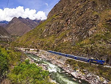 Train between Aguas Calientes and Ollantaytambo through the Sacred Valley, Cusco Region, Peru, South America