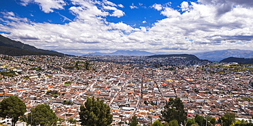 City of Quito with the Historic Centre of Quito Old Town in the foreground, seen from El Panecillo Hill, Quito, Ecuador, South America