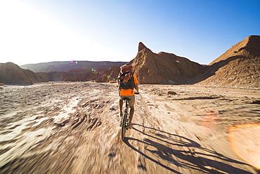 Cycling in the Devil's ravine (Quebrada Del Diablo), part of the Katarpe Valley, San Pedro de Atacama, Atacama Desert, North Chile, Chile, South America