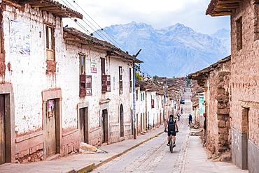 Cycling through Maras, near Cusco (Cuzco), Peru, South America