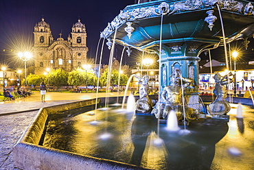 Plaza de Armas Fountain and Church of the Society of Jesus at night, UNESCO World Heritage Site, Cusco (Cuzco), Cusco Region, Peru, South America