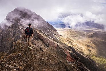 Climber on Ruminahui Volcano summit, Cotopaxi National Park, Avenue of Volcanoes, Ecuador, South America