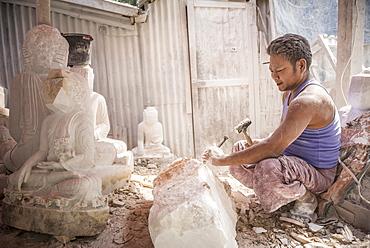 Starting to carve a Buddha image, Mandalay, Mandalay Region, Myanmar (Burma), Asia