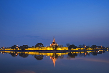 Mandalay City Fort and Palace reflected in the moat surrrounding the compound at night, Mandalay, Myanmar (Burma), Asia