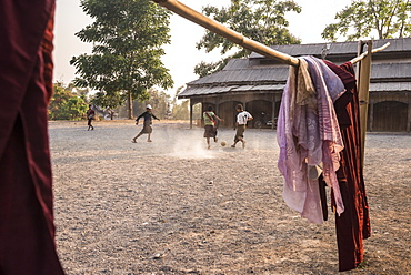 Novice monks playing football at a Buddhist Monastery between Inle Lake and Kalaw, Shan State, Myanmar (Burma), Asia