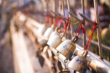 Prayer bells at Golden Rock (Kyaiktiyo Pagoda), Mon State, Myanmar (Burma), Asia