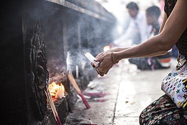 Pilgrims praying at Golden Rock Temple (Kyaiktiyo Pagoda), Mon State, Myanmar (Burma), Asia
