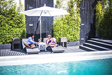Couple on holiday by a swimming pool, Santiago, Chile, South America