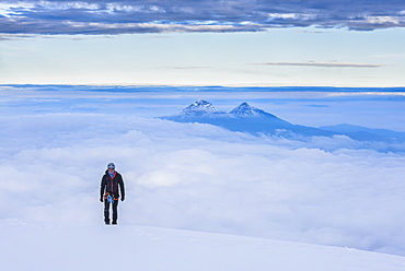 Climber on final 20m to the 5897m summit of Cotopaxi Volcano, Cotopaxi Province, Ecuador, South America