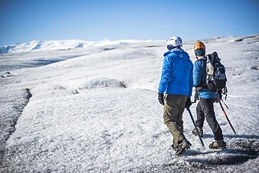 Tourists walking on Breidamerkurjokull Glacier, Vatnajokull Ice Cap, Iceland, Polar Regions