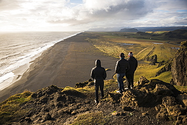 Tourists looking at the view at sunset from Dyrholaey Peninsula, near Vik, South Iceland (Sudurland), Iceland, Polar Regions
