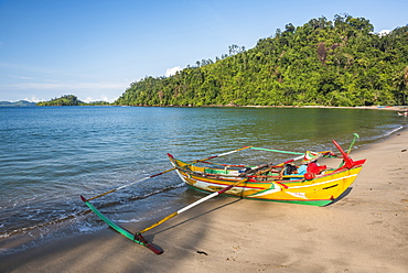 Traditional Indonesian fishing boat on the beach at Sungai Pinang Fishing Village, near Padang in West Sumatra, Indonesia, Southeast Asia, Asia