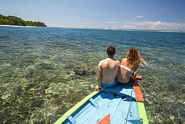 Couple on a traditional Indonesian boat trip to Marak Island, a tropical island near Padang in West Sumatra, Indonesia, Southeast Asia, Asia