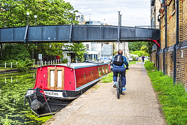 Cycling by the Canal at Ladbroke Grove in the Royal Borough of Kensington and Chelsea, London, England, United Kingdom, Europe