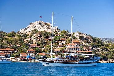 Simena Castle and Gulet sailing boat seen from Kekova Bay, Antalya Province, Lycia, Anatolia, Mediterranean Sea, Turkey, Asia Minor, Eurasia