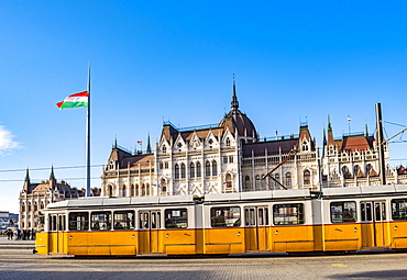 Houses of Parliament and yellow tram, Budapest, Hungary, Europe